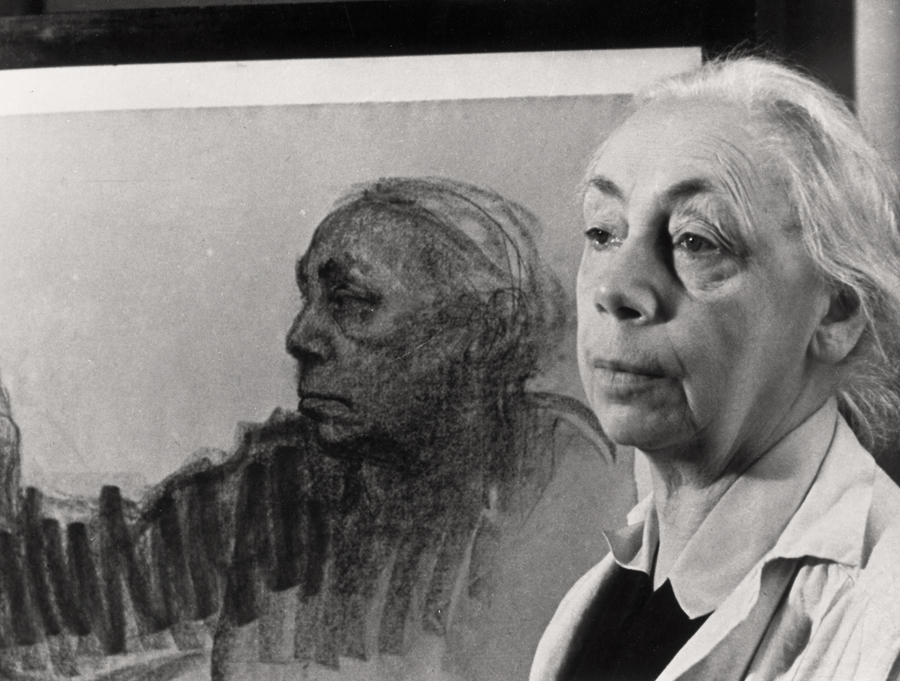 Käthe Kollwitz in front of her self-portrait NT 1240, 1933, A. Grimm © bpk Berlin